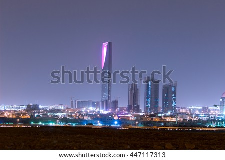 RIYADH, SAUDI ARABIA - OCTOBER 15, 2015: Outside distance skyline view on Riyadh Kingdom tower and other skyscrapers at night, part of full panorama