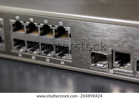 rj45 ports and gbic port on front panel of a switch - stock photo