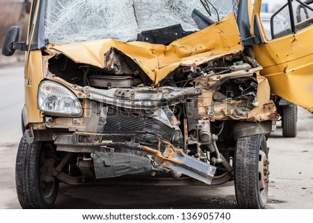 Road accident crash damaged car or wreck broken vehicle - stock photo