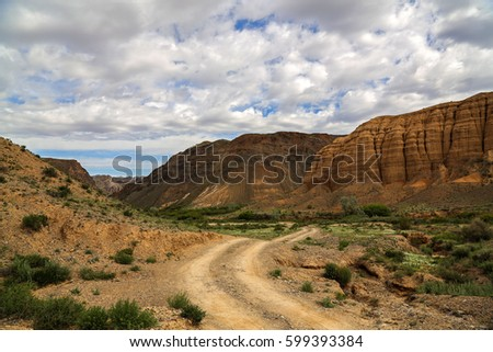 Road across red rocks