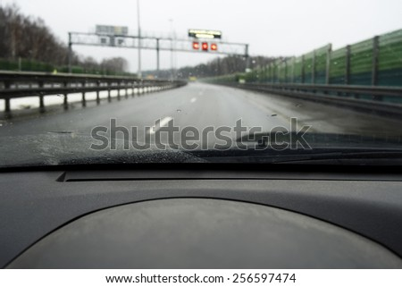 Road ahead with warning signs flashing, outdoor shot with particular focus - stock photo