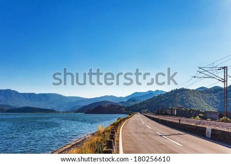 Road along the sea to mountains. Montenegro - stock photo