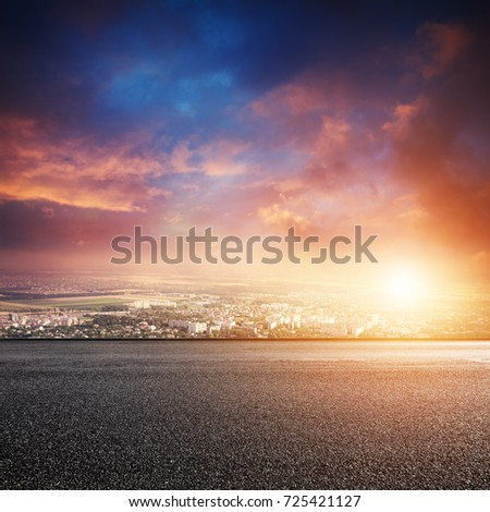 Road and cityscape at sunset. Urban landscape