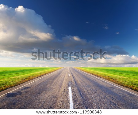 Road and dark sky. Abstract background - stock photo
