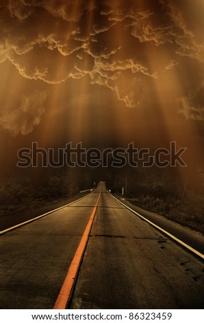 road and dark thunder clouds over it - stock photo