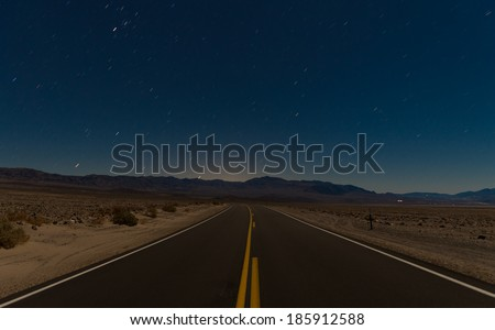road and desert in the night - stock photo