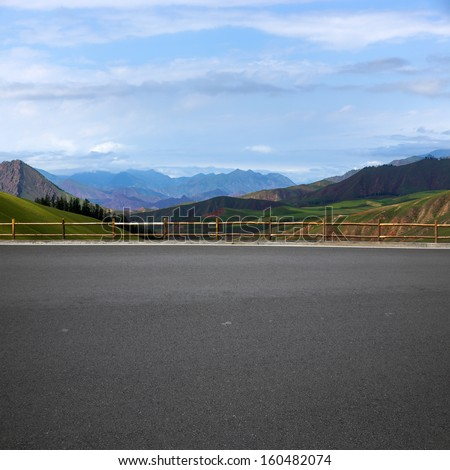 Road and mountain background  - stock photo