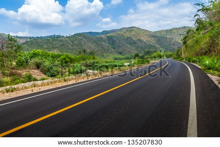 Road and mountain in the province of Thailand. - stock photo