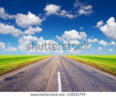 Road and sky with white clouds. Abstract landscape