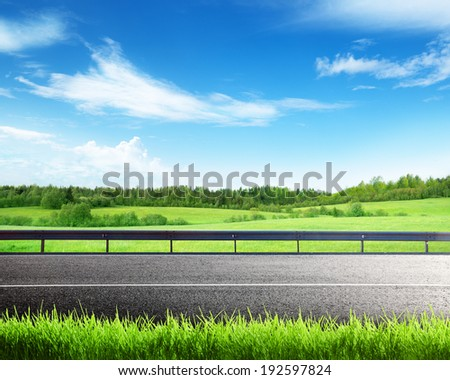 road and spring grass - stock photo