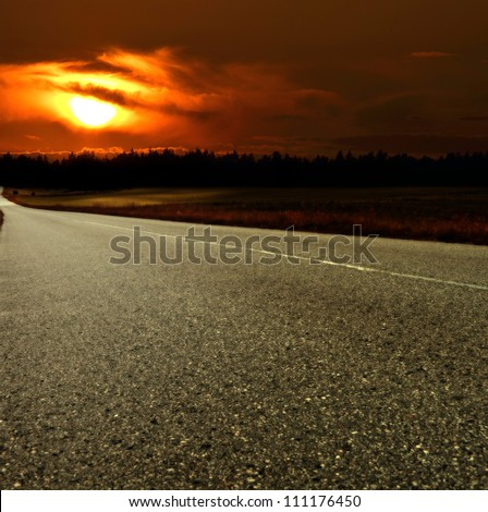 Road and sunset - stock photo