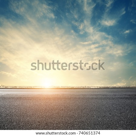 road and sunset sky above city, urban scenery