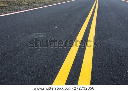 Road and yellow line - stock photo
