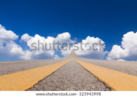 Road asphalt suspended to the sky over the clouds - stock photo