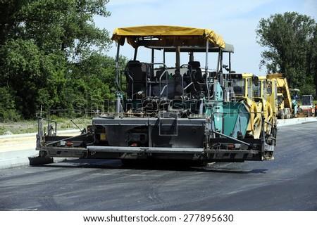 Road asphalting - stock photo