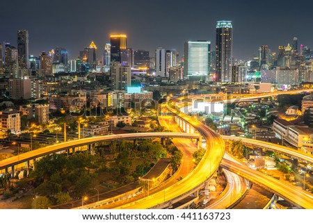 road at night in Bangkok city , Thailand.