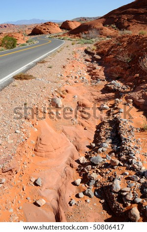 Road Bed Erosion in the Desert - stock photo
