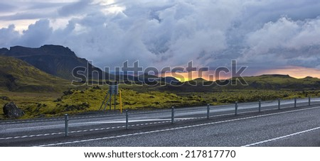 Road beside surreal landscape with wooly moss of Iceland - stock photo