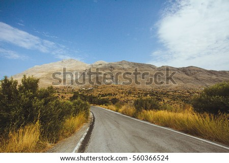 Road between hills in Greece