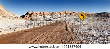 Road between hills in the Atacama desert in Chile - stock photo
