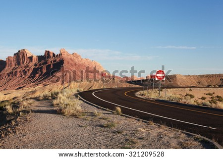 Road between Utah and Arizona states with sign STOP - stock photo