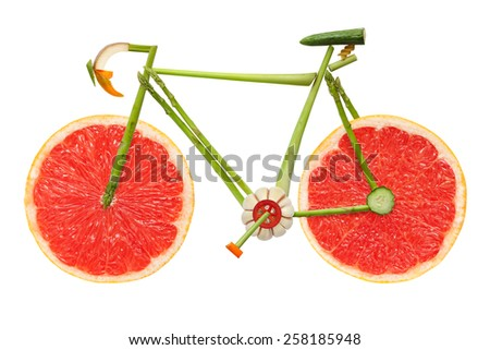Road bicycle made of fruits and vegetables on white background. - stock photo