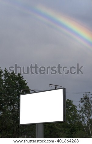 road billboard against the sky with a arainbow