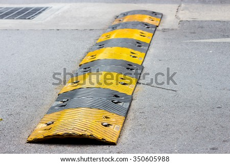 road bump in yellow and black - stock photo