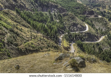 Road climbs mountainside in Andes, Peru - stock photo