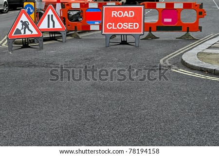 Road closed sign and boundary at construction site