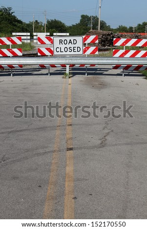 Road closed sign on a country road - stock photo