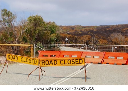 Road closed sign. This road is closed for traffic after the bush fires in Torndirrup, Western Australia - stock photo