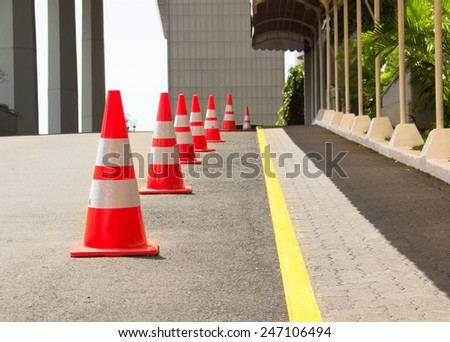 Road Cones Lined Up On The Road - stock photo