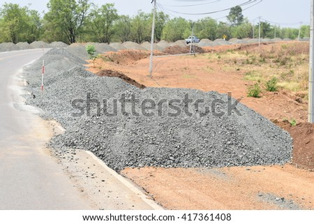 Road Construction Gravel  piles; Construction industry; Building materials - stock photo