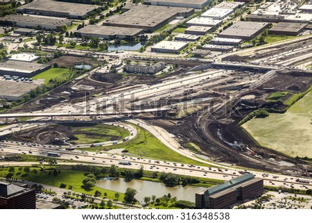 Road construction in industrial area from above - stock photo