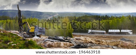 road construction, rock-blasting and drilling machinery, civil-engineering concept - stock photo