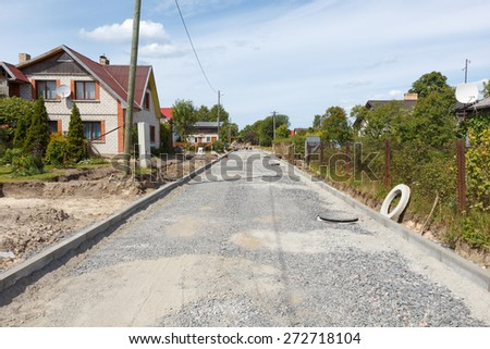 Road construction site without equipment covered in gravel - stock photo