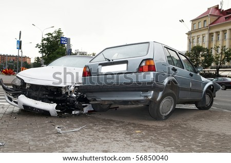 road crash accident with extensive damage of car body - stock photo