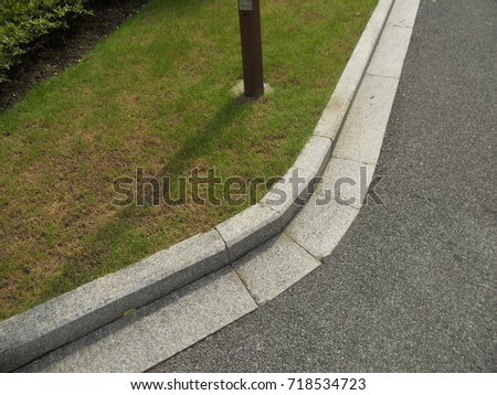 Road curb and grate