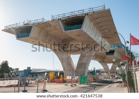 Road currently under construction at several levels to increase traffic. Industrial construction site - stock photo