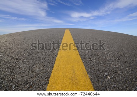 Road curve and blue sky - stock photo