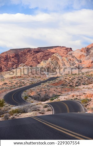 road curves on hill landscape in nevada desert, valley of fire state park - stock photo