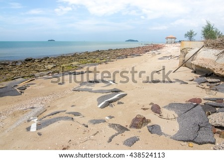 Road debris and buildings collapsed in the sand beach.