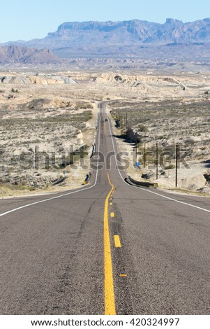 road dropping into the valley by terlingua big bend texas usa