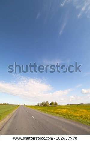 Road, field and sky.