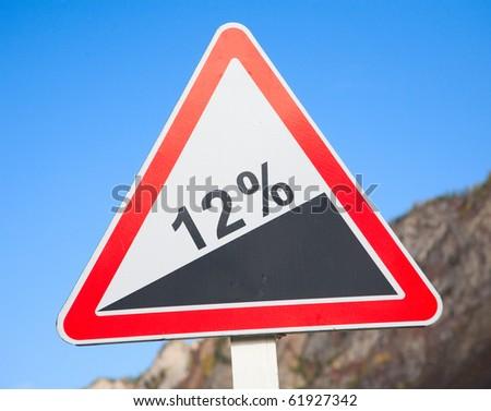 Road grade 12 per cent, road sign - stock photo