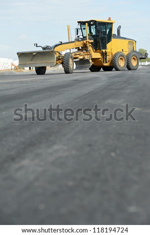 road grader bulldozer at roadwork outdoors