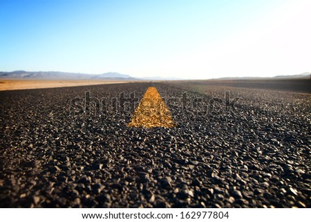 road in a desert at sunset - stock photo