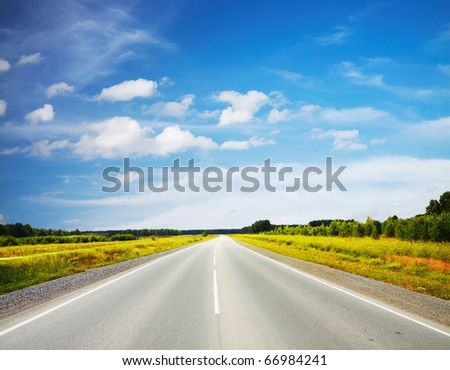 road in a field - stock photo