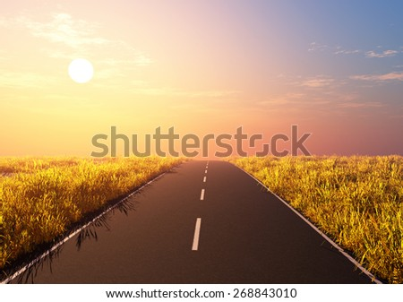 Road in a field on a background of dawn. - stock photo